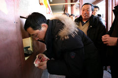Beijing Railway transprot peak. Beijing – January 18, 2009: After waiting a whole hour in line, this guy is very lucky to get a ticket to home. January 18 is royalty free stock photo