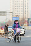 Beijing resident with smog protection, Beijing, China Royalty Free Stock Photography