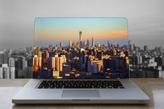 Beijing skyline in laptop computer. Laptop computer over clean and clear skyline of Beijing city. Background is the skyline black and white with air pollution royalty free stock photo