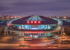 Beijing South Railway Station at twilight, Beijing, China. BEIJING-JULY 4, 2016. Beijing South Railway Station at night. The oval shaped bullet train station is Royalty Free Stock Photos
