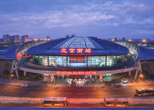 Beijing South Railway Station at twilight, Beijing, China. BEIJING-JULY 4, 2016. Beijing South Railway Station at twilight. The oval shaped bullet train station Royalty Free Stock Image