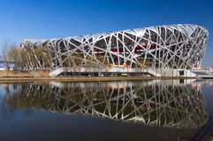 Beijing stadium like Bird`s nest. With reflection in the lake Royalty Free Stock Photos