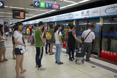 Beijing Subway in Beijing, China. BEIJING-SEP 15: People on subway platform on Sep. 15, 2013 in Beijing, China. Beijing's 17 subway lines carry over 10 million Royalty Free Stock Photo