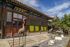 Beijing. Summer Imperial Palace. Bronze figures in front of the facade Hall of Happiness and Longevity (Leshoutang) Stock Photos