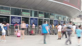 Beijing west railway station at daytime HD. Beijing, China – July 6th, 2014:  Timelapse of people entering the entrance of Beijing west railway station at stock footage