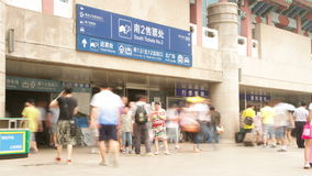 Beijing west railway station at daytime HD. Beijing, China – July 6th, 2014:  Timelapse of people entering the entrance of Beijing west railway station at stock video footage