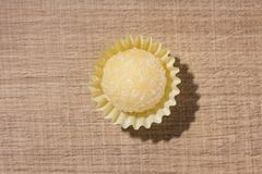 Beijinho is a candy from Brazil: condensed milk and coconut. Chi. Beijinho is a handmade candy from Brazil. Made with condensed milk and coconut. Children royalty free stock image