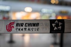 Air China company logo at Beijing airport in China. Beijng, China - October 2017: Air China company logo at Beijing airport in China. Air China is the flag stock images