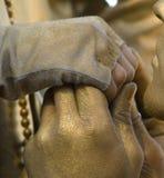 Beijo dourado da mão fotografia de stock royalty free
