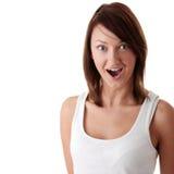 Beiläufige Brunettefrau überrascht Stockbild