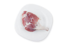 Bein des Huhns auf einer Platte Lizenzfreies Stockfoto