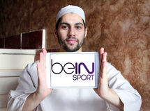 Bein sport logo. Logo of sports television network bein sport on samsung tablet holded by arab muslim man Royalty Free Stock Photo