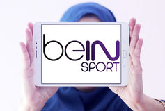 Bein sport logo. Logo of sports television network bein sport on samsung tablet holded by arab muslim woman Stock Photos