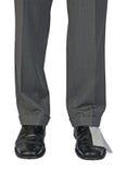 Beine mit Toilettenpapier auf Schuh Stockbilder