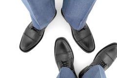 Beine von zwei Männern gegeneinander Stockfoto
