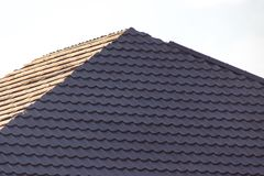 Being built roof of the house. In the park in nature Stock Photos
