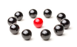 Being the center point. Concept with red and black marbles -  Being the center point Stock Photo
