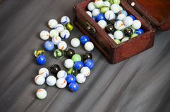 Being a child is playing a marble. The colors are colored marbles, beautiful-looking marbles Stock Photography