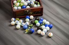 Being a child is playing a marble. The colors are colored marbles, beautiful-looking marbles Royalty Free Stock Images