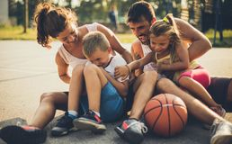 Being a family means being part of something very wonderful. Family on basketball playground. Close up royalty free stock photos