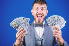 Being flush of money. Rich businessman with us dollars banknotes. Currency broker with bundle of money. Bearded man. Holding cash money. Business startup loan royalty free stock photo