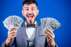 Being flush of money. Rich businessman with us dollars banknotes. Currency broker with bundle of money. Bearded man. Holding cash money. Business startup loan royalty free stock image