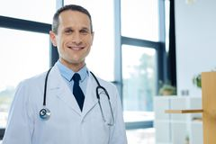 Positive delighted doctor smiling to you Royalty Free Stock Photo
