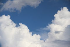 Being heart cloud. Three pieces of clouds are shaping in heart figure Stock Photos