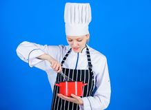 Being inspired by baking recipe. Professional baker making sponge cake recipe by whisking. Pretty cook whipping cream royalty free stock photo