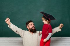 Being joyful and thrilled. Dad and son having fun in Time and its effects. Happy family. Father and son. Happy father. And son over chalkboard. Woohoo royalty free stock image