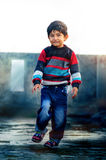 Being Naughty- Portrait of boy child playing on roof Royalty Free Stock Image