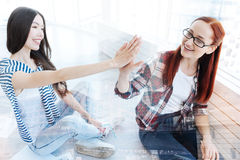 Close up of splendid girls keeping hands together. Being optimistic. Close up of beautiful splendid girls keeping hands together while being happy and joyful Stock Photo