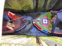 Two narrowboats in lock Royalty Free Stock Photo