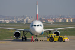 Being pushed from the gate. Jet airplane is being towed from the gate Royalty Free Stock Photos