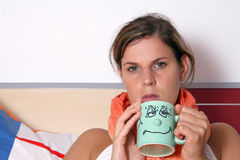 Being sick. A young woman stays home being sick Stock Photography
