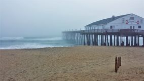 Historic Kitty Hawk Pier on the North Carolina Outer Banks stock images