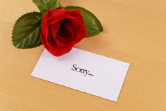Being Sorry. Sorry Note With Rose On Table stock image