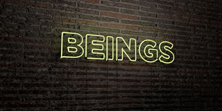 BEINGS -Realistic Neon Sign on Brick Wall background - 3D rendered royalty free stock image Stock Image