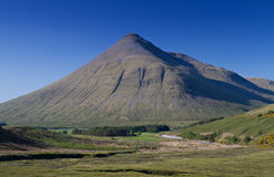Beinn Dorain mountain under a blue sky Stock Images
