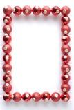 Beira feita dos Baubles vermelhos Fotos de Stock Royalty Free