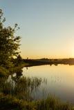 Beira-rio no por do sol Fotos de Stock Royalty Free