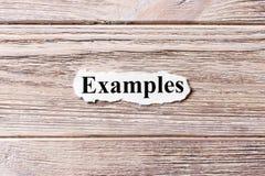 Beispiele des Wortes auf Papier Konzept Wörter von Beispielen auf einem hölzernen Hintergrund Lizenzfreie Stockbilder