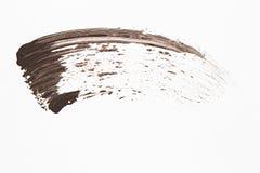 Beispielwimperntusche, lokalisiert auf weißem Hintergrund Stockbild