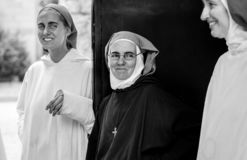 Black and white photo of nuns at women monastery royalty free stock photos
