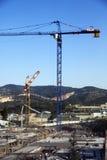 Chantier de construction parmi des collines Photo libre de droits