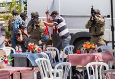 Demonstration of Israel Police Special Unit capture a terrorist in street cafe. BEIT SHEMESH, ISRAEL - APRIL 19, 2018: Demonstration of Israel Police Special stock images