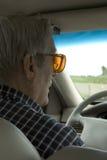 Bejaarde bestuurder Stock Foto's