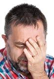 Bejaarde die aan een hoofdpijn lijden royalty-vrije stock afbeeldingen
