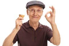 Bejaarde die een koekje eten royalty-vrije stock foto