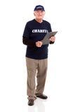 Bejaarde die voor liefdadigheid werken stock foto's